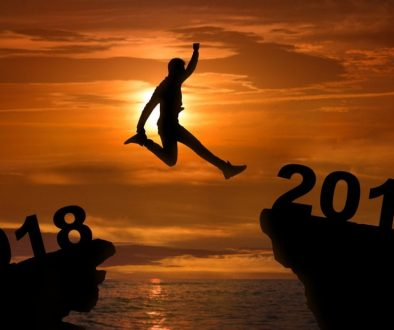 Man jumping between 2018 and 2019 years at sunset